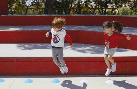 Children playing dressed in Petit Bateau